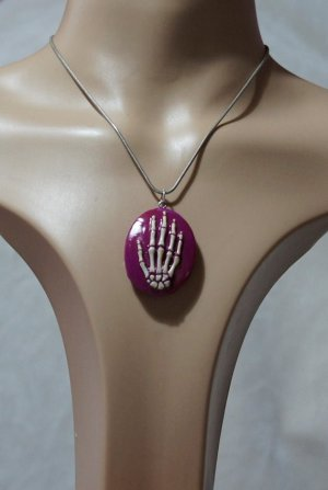Pink and white skeleton hand cameo necklace