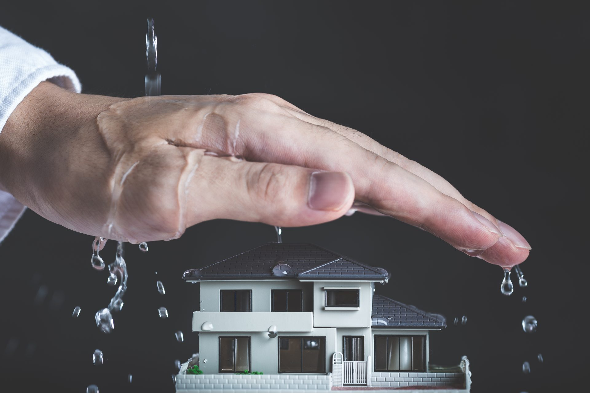 Big hand covering house to provide protection