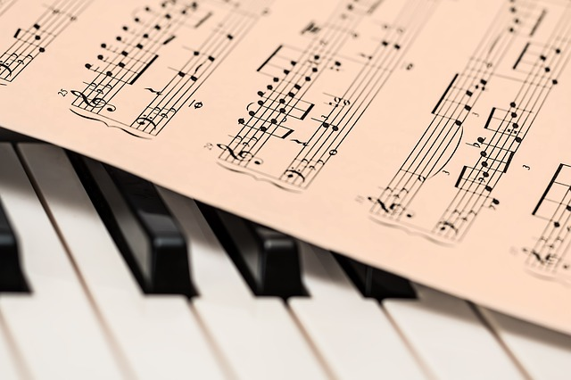 Piano keys with music score