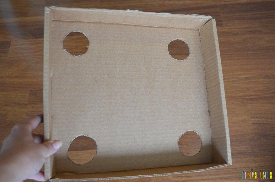 Um brinquedo para praticar a paciência e o sentido de direção - caixa desenhada