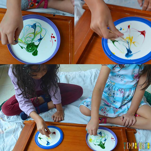 Uma pintura com corante e cola para crianças - meninas pintando