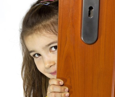16757491 - girl opening the door and mysterious smiling