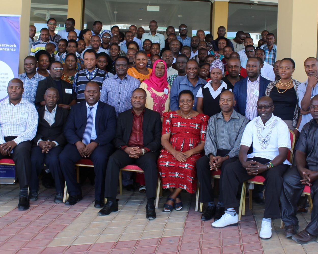 TEN/MET Northern Zone Members (Standing row) in a Group Photo with Outgoing Board Members (Front seats)