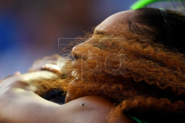Serena Williams of the USA in action against Simona Halep of Romania during their women's singles fourth round match at the Australian Open Grand Slam tennis tournament in Melbourne, Australia, 21 January 2019. EPA-EFE/LUKAS COCH AUSTRALIA AND NEW ZEALAND OUT
