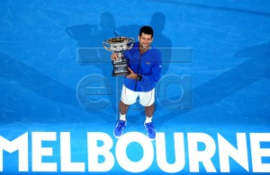 Novak Djokovic of Serbia raises the trophy after winning his men's singles final match against Rafael Nadal of Spain at the Australian Open Grand Slam tennis tournament in Melbourne, Australia, 27 January 2019. EPA-EFE/HAMISH BLAIR EDITORIAL USE ONLY AUSTRALIA AND NEW ZEALAND OUT