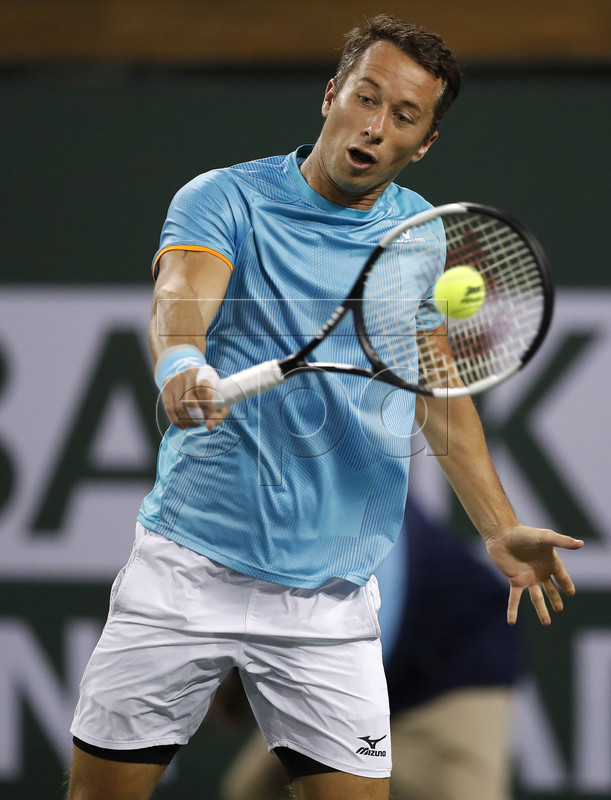 Philipp Kohlschreiber of Germany in action against Gael Monfils of France during the BNP Paribas Open tennis tournament at the Indian Wells Tennis Garden in Indian Wells, California, USA, 13 March 2019. The men's and women's final will be played, 17 March 2019.  EPA-EFE/JOHN G. MABANGLO