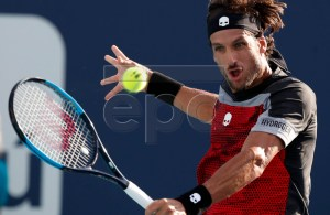 Feliciano Lopez of Spain in action against Benoit Paire of France during their match at the Miami Open tennis tournament in Miami, Florida, USA, 21 March 2019. EPA-EFE/JASON SZENES