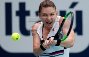 Simona Halep of Romania in action against Wang Qiang of China during their women's quarterfinals singles match at the Miami Open tennis tournament in Miami, Florida, USA, 27 March 2019. EPA-EFE/JASON SZENES