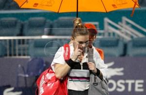 Simona Halep of Romania walks off the court during a rain delay in her match against Karolina Pliskova of the Czech Republic during their semifinals match at the Miami Open tennis tournament in Miami, Florida, USA, 28 March 2019. EPA-EFE/JASON SZENES