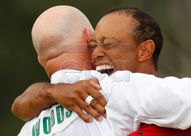 Tiger Woods of the US celebrates with caddie Joe LaCava (L) after winning the 2019 Masters Tournament at the Augusta National Golf Club in Augusta, Georgia, USA, 14 April 2019. The 2019 Masters Tournament is held 11 April through 14 April 2019. EPA-EFE/ERIK S. LESSER