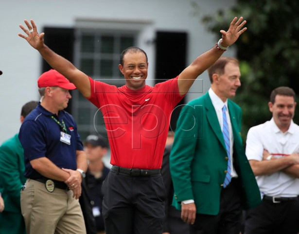 Tiger Woods of the US celebrates as he arrives to receive his fifth green jacket after winning the 2019 Masters Tournament at the Augusta National Golf Club in Augusta, Georgia, USA, 14 April 2019. The 2019 Masters Tournament is held 11 April through 14 April 2019. EPA-EFE/TANNEN MAURY
