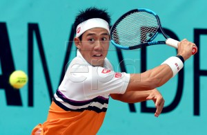 Kei Nishikori of Japan in action against Stan Wawrinka of Switzerland during their third round match of the Mutua Madrid Open tennis tournament at the Caja Magica complex in Madrid, Spain, 09 May 2019. EPA-EFE/FERNANDO VILLAR