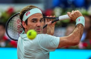 Swiss player Roger Federer in action during his first round match against France's Richard Gasquet at the Mutua Madrid Open tennis tournament in Madrid, Spain, 07 May 2019. EPA-EFE/JUANJO MARTIN