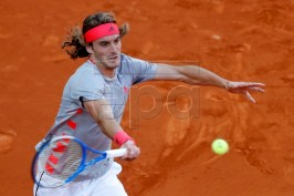 Stefanos Tsitsipas of Greece in action during final match against Novak Djokovic of Serbia at the Mutua Madrid Open tennis tournament, in Madrid, Spain, 12 May 2019.  EPA-EFE/JAVIER LIZON