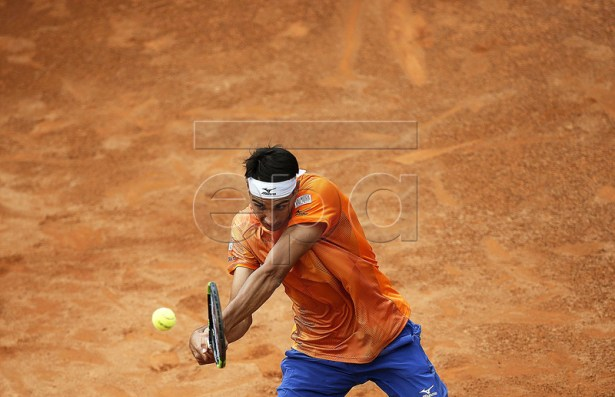 Lorenzo Sonego of Italy in action against Karen Khachanov of Russia during their men's singles first round match at the Italian Open tennis tournament in Rome, Italy, 13 May 2019.  EPA-EFE/RICCARDO ANTIMIANI