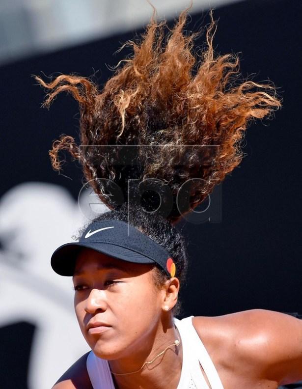 Naomi Osaka of Japan in action against Dominika Cibulkova of Slovakia during their women's singles second round match at the Italian Open tennis tournament in Rome, Italy, 16 May 2019.  EPA-EFE/ETTORE FERRARI