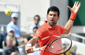Novak Djokovic of Serbia plays Hubert Hurkacz of Poland during their men?s first round match during the French Open tennis tournament at Roland Garros in Paris, France, 27 May 2019. EPA-EFE/JULIEN DE ROSA