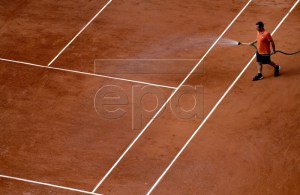 Staff member waters the court as Novak Djokovic of Serbia plays Hubert Hurkacz of Poland during their men?s first round match during the French Open tennis tournament at Roland Garros in Paris, France, 27 May 2019. EPA-EFE/JULIEN DE ROSA