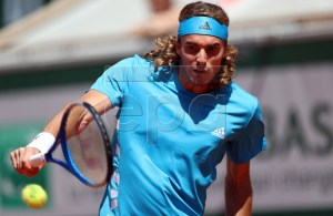 Stefanos Tsitsipas of Greece plays Filip Krajinovic of Serbia during their men?s third round match during the French Open tennis tournament at Roland Garros in Paris, France, 01 June 2019. EPA-EFE/SRDJAN SUKI