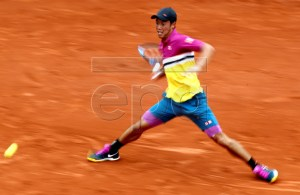 Kei Nishikori of Japan plays Benoit Paire of France during their men?s round of 16 match during the French Open tennis tournament at Roland Garros in Paris, France, 03 June 2019. EPA-EFE/YOAN VALAT
