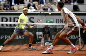 Rafael Nadal of Spain (L) plays Roger Federer of Switzerland during their men?s semi final match during the French Open tennis tournament at Roland Garros in Paris, France, 07 June 2019. EPA-EFE/JULIEN DE ROSA
