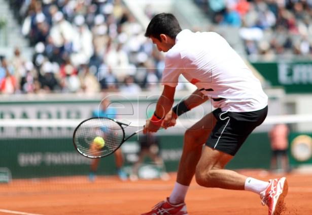 Novak Djokovic of Serbia plays Dominic Thiem of Austria during their men?s semi final match during the French Open tennis tournament at Roland Garros in Paris, France, 08 June 2019. EPA-EFE/SRDJAN SUKI