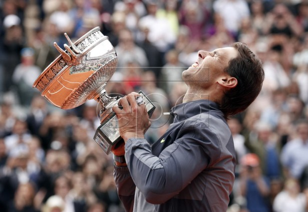 Rafael Nadal of Spain poses with the trophy after winning the men?s final match against Dominic Thiem of Austria during the French Open tennis tournament at Roland Garros in Paris, France, 09 June 2019. EPA-EFE/YOAN VALAT