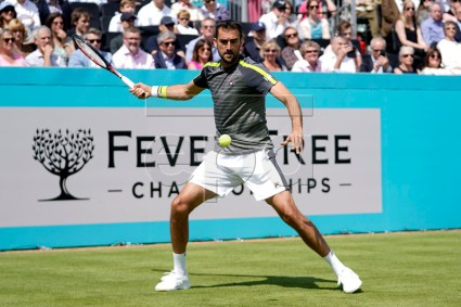 Croatia's Marin Cilic returns to Chile's Cristian Garin during their round 32 match at the Fever Tree Championship at Queen's Club in London, Britain, 17 June 2019. The tournament runs from 17th June till 23 June 2019. EPA-EFE/WILL OLIVER
