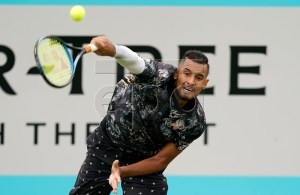 Australia's Nick Kyrgios serves to Spain's Roberto Carballes Baena during their round 32 match at the Fever Tree Championship at Queen's Club in London, Britain, 20 June 2019. EPA-EFE/WILL OLIVER