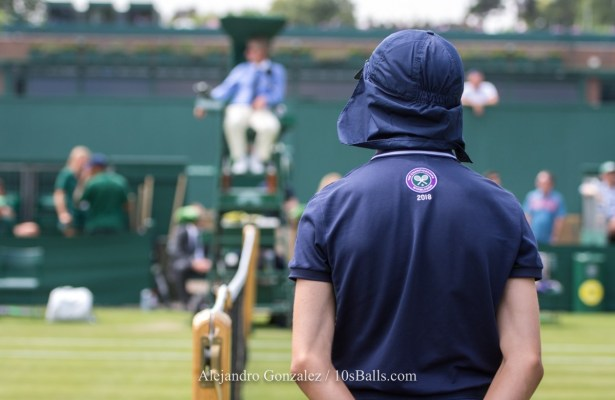 A ball boy stands on Court 17 at the 2018 Wimbledon Championships tennis tournament in London, Great Britain, on Wednesday, July 4, 2018.