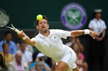 Novak Djokovic of Serbia returns to Philipp Kohlschreiber of Germany in their first round match during the Wimbledon Championships at the All England Lawn Tennis Club, in London, Britain, 01 July 2019. EPA-EFE/ANDY RAIN EDITORIAL USE ONLY/NO COMMERCIAL SALES