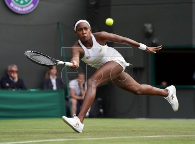 Cori Gauff of the US returns to compatriot Venus Williams in their first round match during the Wimbledon Championships at the All England Lawn Tennis Club, in London, Britain, 01 July 2019. EPA-EFE/NIC BOTHMA EDITORIAL USE ONLY/NO COMMERCIAL SALES