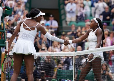 Cori Gauff of the US (R) at the net with compatriot Venus Williams whom she defeated in their first round match during the Wimbledon Championships at the All England Lawn Tennis Club, in London, Britain, 01 July 2019. EPA-EFE/NIC BOTHMA EDITORIAL USE ONLY/NO COMMERCIAL SALES