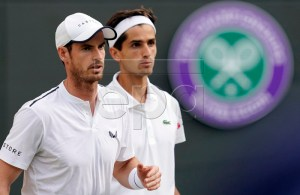 Andy Murray (L) of Britain and Pierre-Hugues Herbert of France in action during their Men's Doubles match against Marius Copil of Romania und Ugo Humbert of France at the Wimbledon Championships at the All England Lawn Tennis Club, in London, Britain, 04 July 2019. EPA-EFE/WILL OLIVER EDITORIAL USE ONLY/NO COMMERCIAL SALES