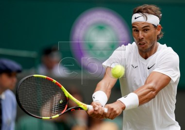 Rafael Nadal of Spain in action against Jo-Wilfried Tsonga of France during their third round match at the Wimbledon Championships at the All England Lawn Tennis Club, in London, Britain, 06 July 2019. EPA-EFE/WILL OLIVER EDITORIAL USE ONLY/NO COMMERCIAL SALES