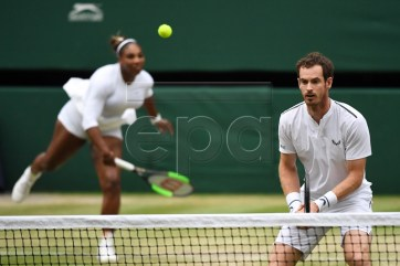 Andy Murray of Britain and Serena Williams of the US during their second round mixed doubles match against Fabrice Martin of France and Raquel Atawo of USA at the Wimbledon Championships at the All England Lawn Tennis Club, in London, Britain, 09 July 2019. EPA-EFE/ANDY RAIN EDITORIAL USE ONLY/NO COMMERCIAL SALES