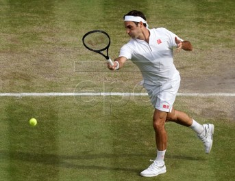 Roger Federer of Switzerland in action against Novak Djokovic of Serbia during their Men's final match for the Wimbledon Championships at the All England Lawn Tennis Club, in London, Britain, 14 July 2019. EPA-EFE/WILL OLIVER EDITORIAL USE ONLY/NO COMMERCIAL SALES