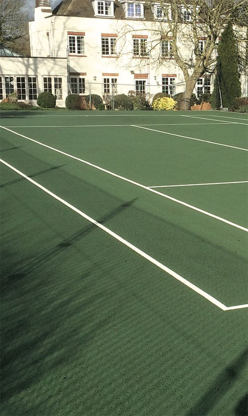 A tennis court carpet cleaned by EnTC