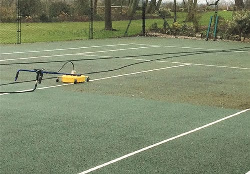 EnTC cleaning a tarmac tennis court