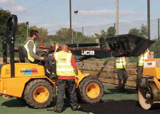 Resurfacing a tennis court