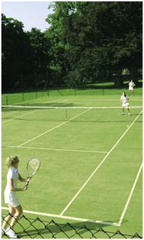 Mixed doubles on an En Tout Cas tennis court