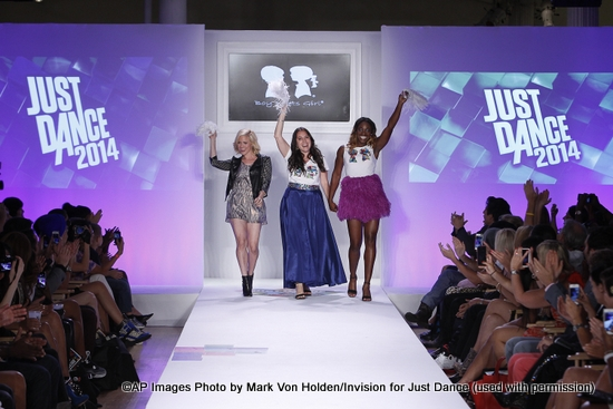 Actress Brittany Snow, fashion designer Stacey Igel, Sloane Stephens walks the runway at STYLE360 during the Just Dance with Boy Meets Girl fashion show on Thursday, September 12, 2013, in New York City. The collection is inspired by the style, look and energy of the new and highly anticipated Just Dance 2014, due out in October.(Photo by Mark Von Holden/Invision for Just Dance/AP Images)
