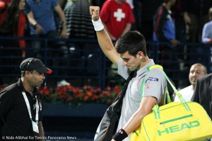 Djokovic thumbs up to fans while leaving