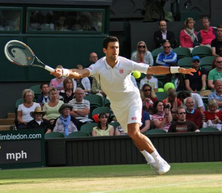WIMBLEDON, UK, NOVAK DJOKOVIC, STRETCHING WITH HEAD RACQUET