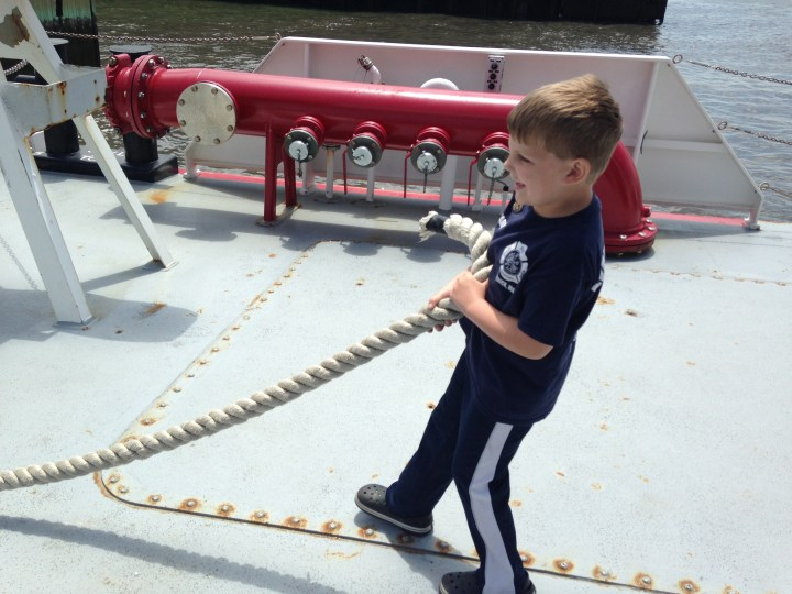 Edward pulls rope on the fire boat