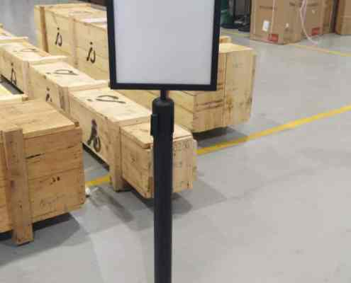 black queue pole with A3 vertical sign
