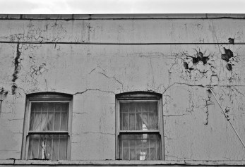 Photo by Kevin McConnell Old industrial buildings cut deep and disconnected from modern day life around them, yet still used and valued for their character and flaws.
