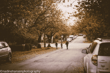 Photo by Nadine Hansen Road hockey on a leafy street.