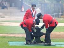 As the smoke still clears from the previous shot, members of the Hyack Anvil Battery set up the anvils for the next one. Photo by Mario Bartel