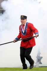 Kevin Kirkland, of the Hyack Anvil Battery, makes a hasty retreat after igniting the gunpowder between two heavy iron anvils. Photo by Mario Bartel